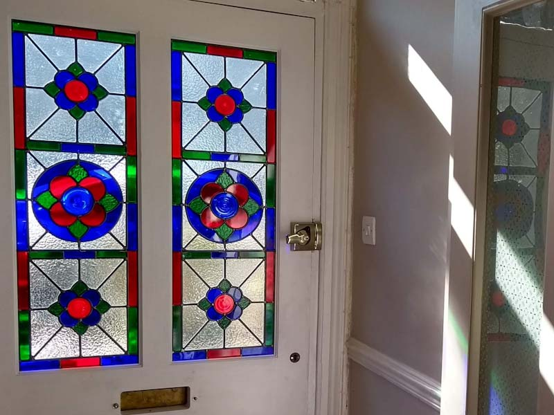 pair of stained glass from door panels fitted in a new door in Street, Somerset